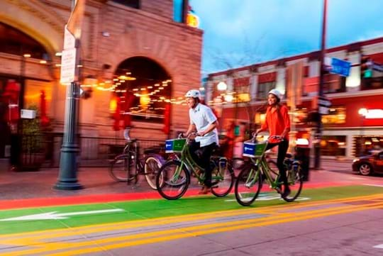 Couple riding green bikes