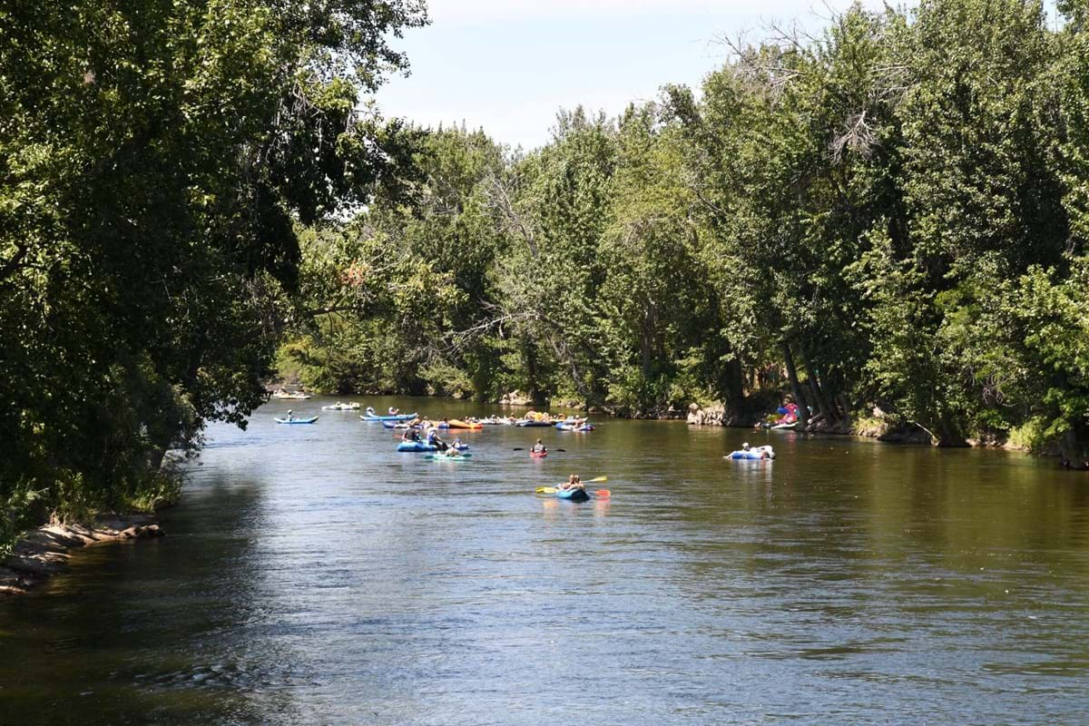River with people floating on tubes and rafts