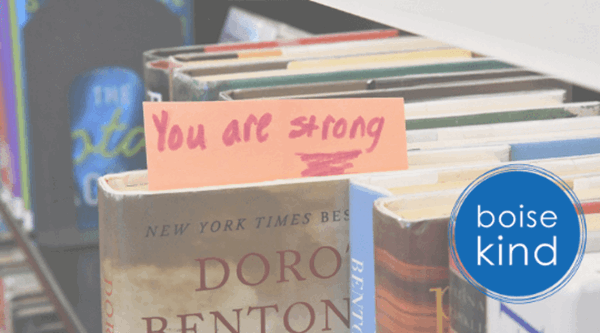 "Book pulled out on shelf with note coming out saying ""You are Strong"" - logo reads ""Boise Kind"""