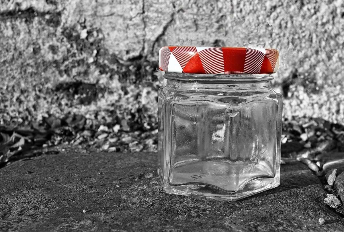 glass jar with red metal lid.