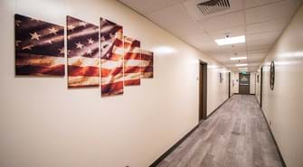 Hallway with artwork featuring the American flag