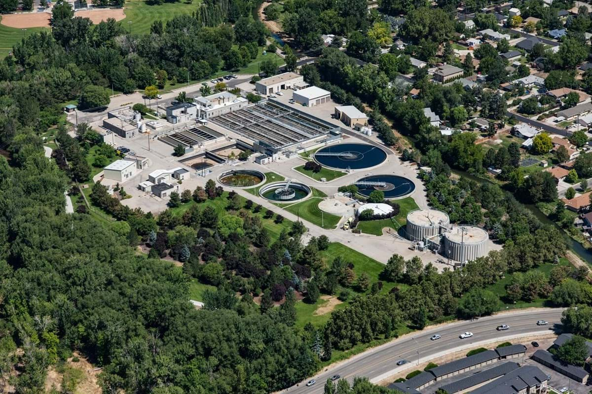Aerial view of a water treatment facility surrounded by trees