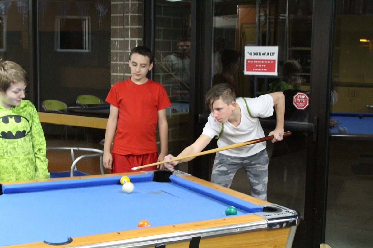 Teens playing pool