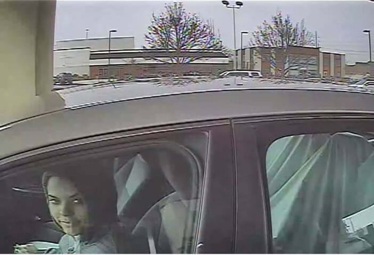 woman in car and gray hoodie