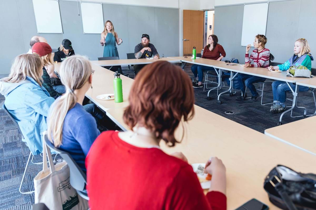 Woman addressing group in conference room