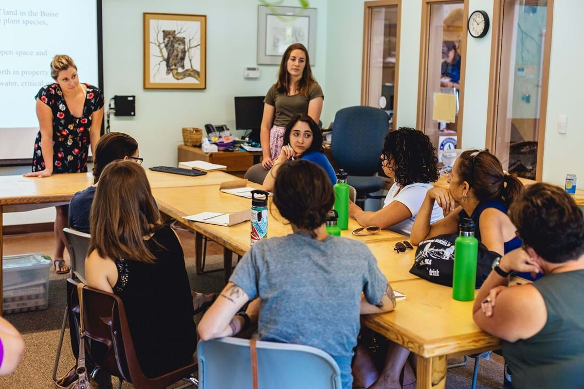 Woman talking to group in classroom
