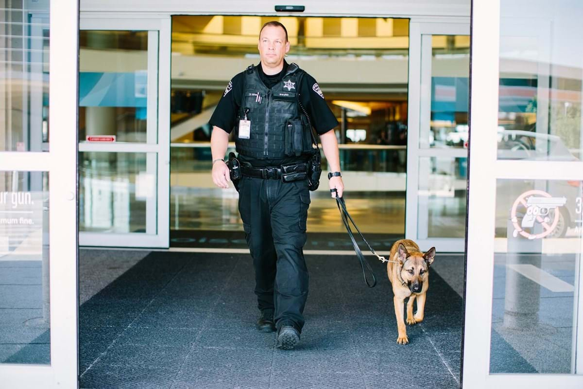 Officer walking with K9 unit