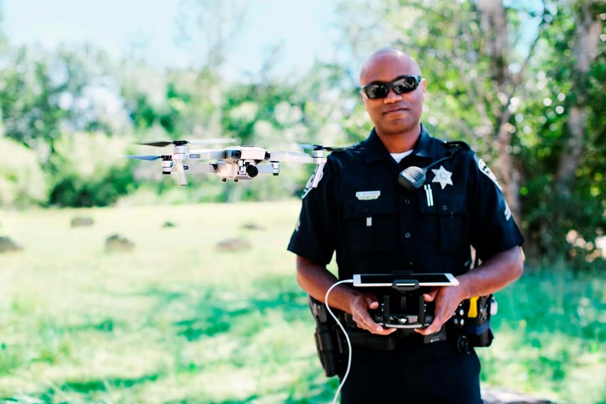 Police officer flying drone