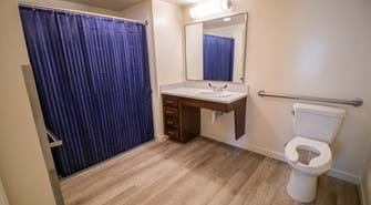 Bathroom with blue shower curtain, sink and toilet
