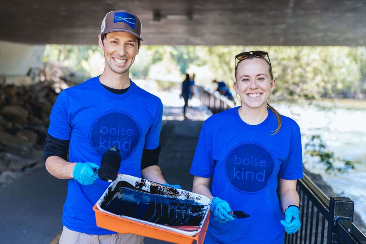 A man and woman wearing blue shirts that read Boise Kind