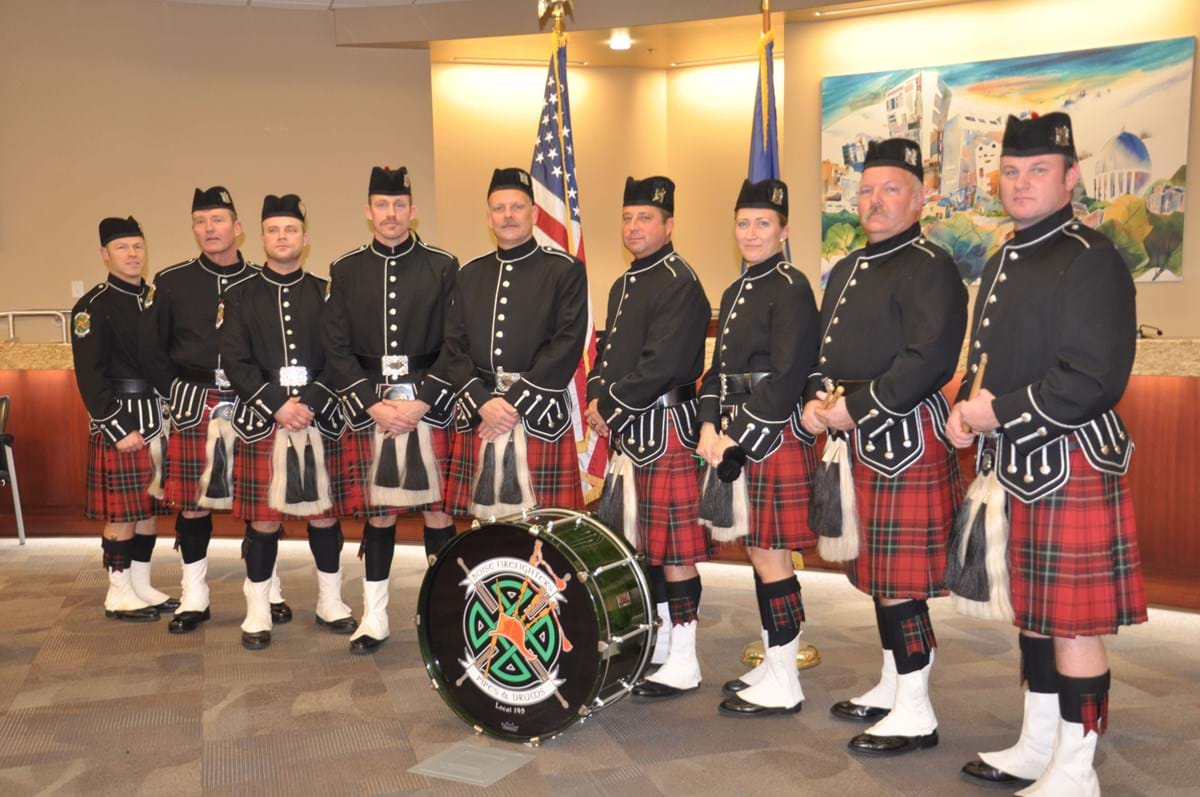 Boise Firefighters Pipes and Drums lined up in kilts