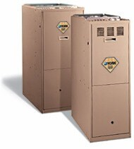 Two upright furnaces in beige color